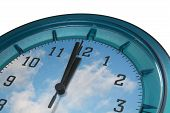 stock photo of last day work  - wall clock with clouds as background - JPG