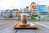Thai Style Iced Espresso Coffee By The Bangkok Canal. poster