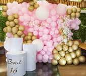 Festive Decoration With Bright Balloons Filled With Helium. Pink, White, Golden Balls And Golden Twi poster