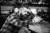 Bar Is Relaxing Place Have Drink And Relax. Man With Beard Spend Leisure In Dark Bar. Brutal Hipster poster
