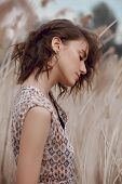 Beautiful Girl In A Field With Tall Grass In Autumn. Art Portrait Of A Woman, Romantic Mysterious Lo poster