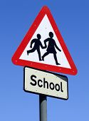 stock photo of school child  - Close up of a British School roadside warning sign - JPG