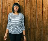 Beautiful young african american woman wearing stripes sweater over isolated background sticking ton poster