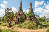 Local People Walking Pass Nyaung Ohak Pagodas The Group Of Ancient Pagodas In Indein Village West Of poster