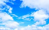 Vibrant Blue Sky With Clouds Background With Tiny Clouds Floating In The Sky In Daylight. Natural Sk poster