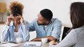 Bankruptcy And Investment Mistakes. African American Husband Comforting His Crying Wife On Meeting W poster