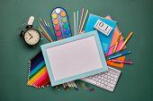 Blue frame with blank sheet, computer keyboard, stationery accessories: pencils and other office sup poster