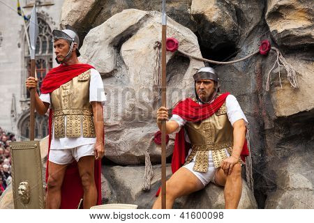 BRUGES, BELGIUM - MAY 17: Annual Procession of the Holy Blood on Ascension Day. Roman soldiers and tomb of Christ - locals perform dramatizations of Bible. May 17, 2012 in Bruges (Brugge), Belgium