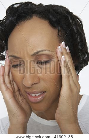 Portrait of African American woman with severe headache