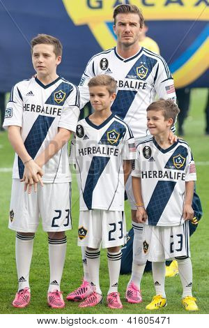 CARSON, CA - DECEMBER 1: David, Brooklyn, Romeo, and Cruz Beckham before the 2012 MLS Cup at the Home Depot Center on December 1, 2012 in Carson, California.