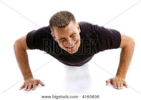 Smiling Muscular Male Doing Push Ups