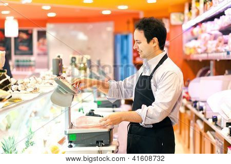 Buthcer in his supermarket