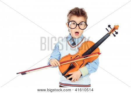 Portrait of a cute little boy posing with his violin. Isolated over white background.