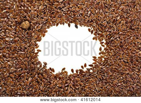 border frame of flax seeds on white background with copy space