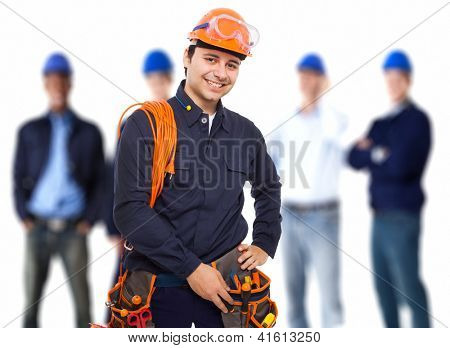Portrait of a smiling worker in front of his team