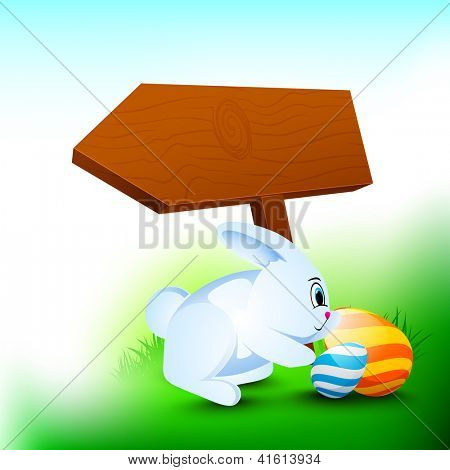 Happy Easter background with little rabbit, painted eggs and wooden sign board for your message.
