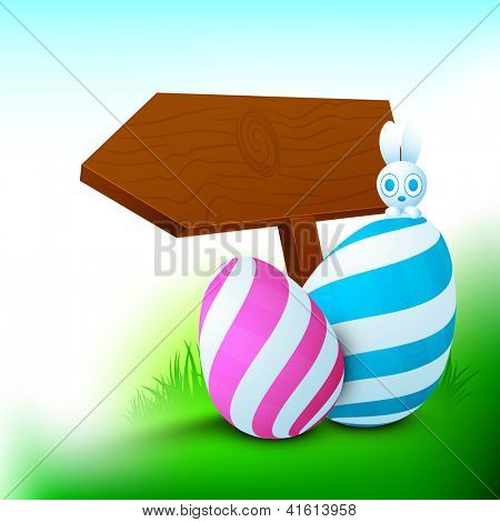 Easter bunny with beautiful painted eggs and wooden sign board for your message. Happy Easter Background.