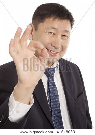 Adult asian business man with ok hand gesture. Isolated on white background