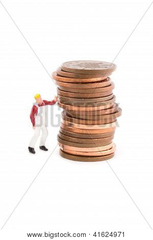 Minature Figure Holding Up A Coin Over White