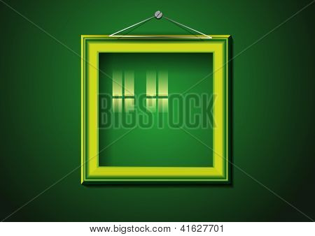 Retro picture frame on green wall