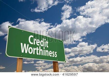 Credit Worthiness Green Road Sign Over Clouds and Sky.