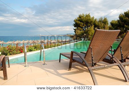 Swimming Pool By A Beach At The Modern Luxury Hotel, Halkidiki, Greece