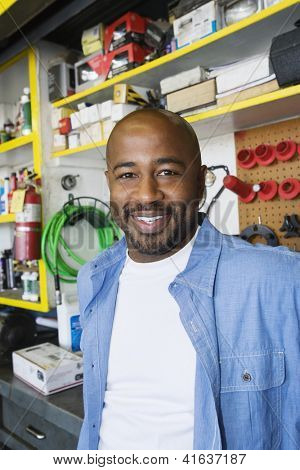 Portrait of a happy African American industrial worker at workplace