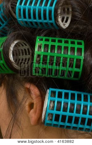 Close-up Shot Of Young Woman's Hair Curlers