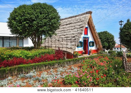 Old house-museum of the first settlers on the island of Madeira. Charming white cottage with a thatched roof gable