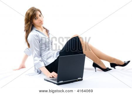 Young Businesswoman With Laptop Lying On The Floor.