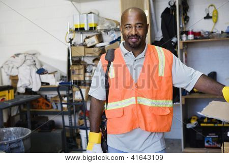 Portrait of an African American construction worker standing at workplace