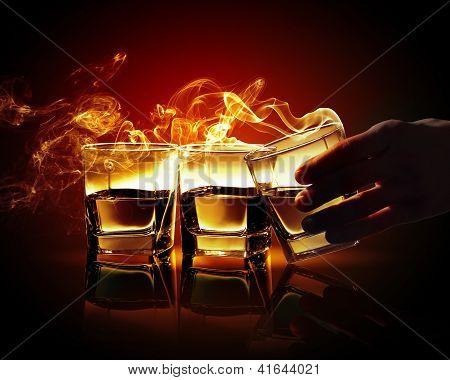 Three glasses of yellow absinth