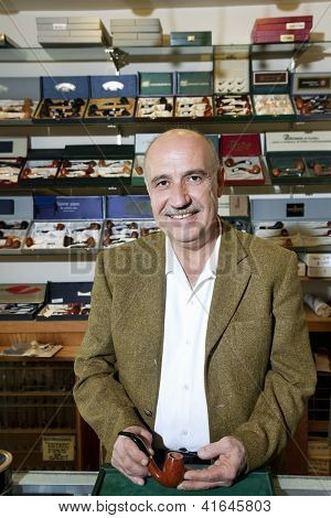 Portrait of a middle-aged tobacco shop owner