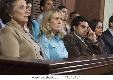 Group of multi ethnic business people sitting at court house