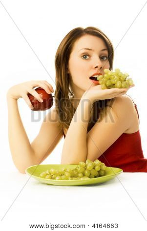 Sexy Woman With Grapes And An Apple