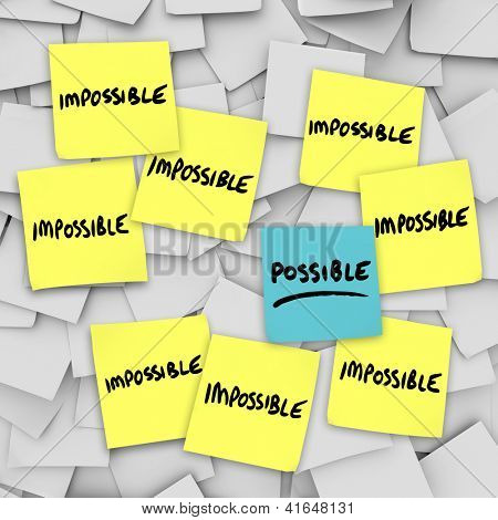 The words Possible and Impossible on sticky notes to symbolize good positive attitude and thinking of opportunity