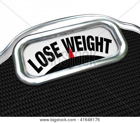 Las palabras de perder peso en la pantalla de una escala a decirle tienes que ir en una dieta de gota libras
