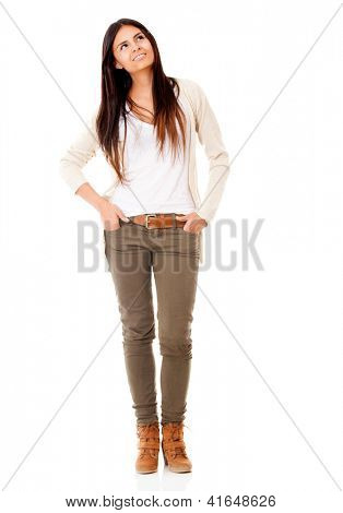 Pensive casual woman - isolated over a white background