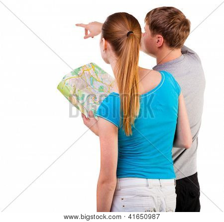 Back view journey of the young couple looking at the map. travelers man and woman in shorts consider recreation.. Rear view people collection. backside view of person. Isolated over white background.