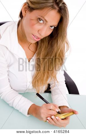 Top View Of Manager Writing On Paper