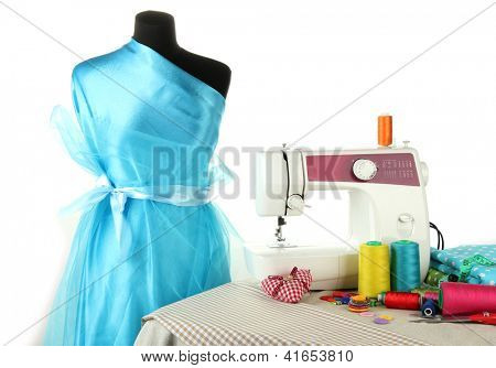 Sewing machine, dummy and other sewing equipment isolated on white