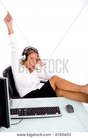Front View Of Smiling Manager Listening Music