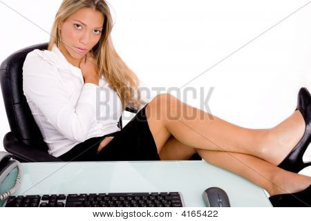 Front View Of Sitting Businesswoman Looking At Camera