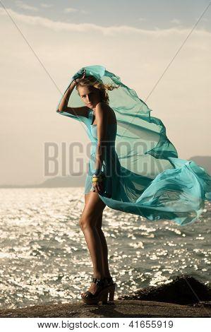 Portrait Of Fashion Woman In Fluttering Blue Dress