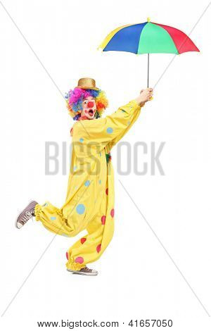Full length portrait of a male clown with umbrella isolated on white background