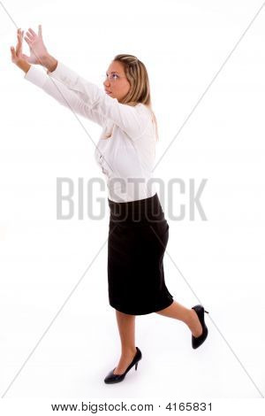 Side View Of Businesswoman Showing Directing Gesture