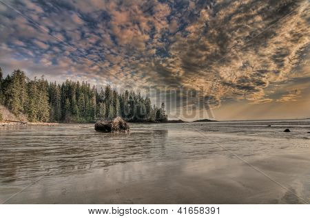 Vast Beach With Amazing Clouds And Big Rock
