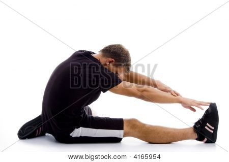 Muscular Guy Stretching His Legs And Hands