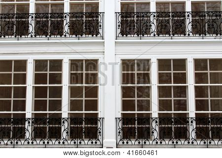 Row of white windows with black railing