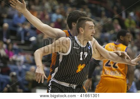 VALENCIA - JANUARY 29: Axel Hervelle #17 during Bakestball match between Valencia Basket Club and Uxue Bilbao, on January 29, 2013, in La Fonteta Stadium, Valencia, Spain